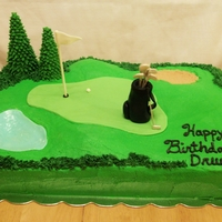 Golf Themed Birthday Cake This is a deep dark chocolate 1/2 sheet cake with mocha filling, covered in buttercream. Trees are sugar (ice cream) cones with royal icing...