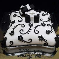 "Black & White Pillow Cake Chocolate cake with mocha filling covered with fondant. Pillow shape was carved from an 8"" square cake. The floral design was done..."