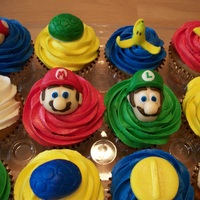 Mario Kart Cupcakes Vanilla cupcakes with brightly colored vanilla buttercream and fondant Mario Kart toppers.