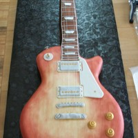 Gibson Les Paul Guitar Cake This is a life-size Gibson Les Paul Standard guitar done as a groom's cake. The body of the cake is red velvet cake with cream cheese...
