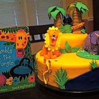 Rumble In The Jungle This is for my daughters 1st birthday cake. It is based off of her favorite book 'Rumble in the Jungle'. I even incorporated her...