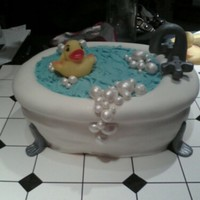 Rub-A-Dub-Dub This was for a baby shower. Vanilla cake covered in MMF with fondant faucet and feet. BC water and a non-edible rubber ducky. Thanks for...