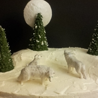 White Wolves Wolves made of fondant/gum paste, trees made of ice cream cones covered with royal icing.