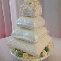 Pillow Wedding Cake. Four tier pillow wedding cake with over two thousand hand placed pearls and handmade sugar flowers.