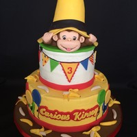 Curious George Buttercream cake, fondant and gumpaste decorations. The hat base is RKT. This is the third cake I've made for this little girl.