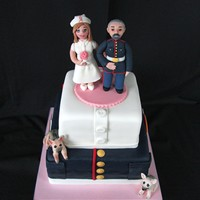 Nurse & Marine This cake was for a casual second wedding. They wanted the groom, a former Marine, in his dress blues and the bride, a nurse at a breast...