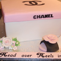 "Chanel Shoebox Cake Used Wilton black sugar lettering for the word ""Chanel"". The writing on the cake board was also done with Wilton sugar sheets and..."