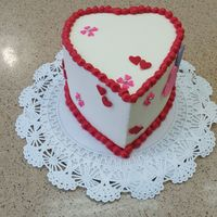 Mini Valentines Cake mini red velvet heart cake w/ cream cheese filling and swiss butter cream out side