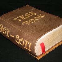 Year Book This book was the top layer of a cake I did for the local schools 50th birthday. Chocolate mud. A favourite for most aussies at the moment...