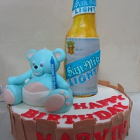 Bear And Beer Cake the cake is the beer bottle made of rum cake =) bear is made of fondant =) labels are hand painted =)