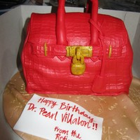 Croc Skin Hermes Birkin Bag cake is made of chocolate cake with ganache filling, carved into the shape of a hermes bag =) TFL