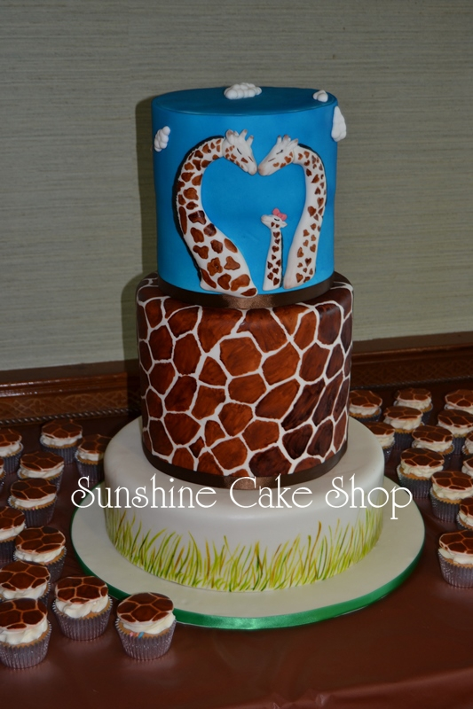 "Giraffe Theme Baby Shower Cake This cake was MASSIVE. It is a 14"" on the bottom and a double barrel 10"" and 8"" on top. We guestimated that it weighed about..."