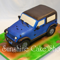 "3D Jeep Wrangler This was for my son's 6th birthday. It was carved from 2 - 9""x13"" cakes and 1 - 8""x8"" cake. Tires, fender flares,..."