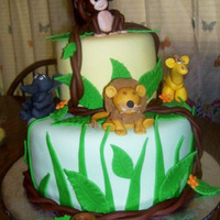 Jungle Cake Baby Shower cake with buttercream icing covered with marshmellow fondant. Animails made with fondant/gumpaste.