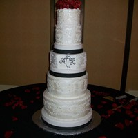 White, Black, And Red Wedding Cake This cake was done for a very special couple, the groom helped design it, he wanted it to reflect the brides lace on her dress and their...