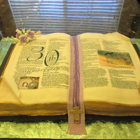 Open Bible Cake This cake was done for a Pastor's 30th anniversary of being pastor. It fed 100 people, and was strawberry on one side and chocolate...