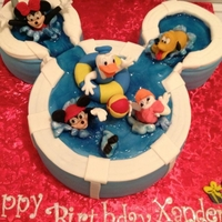 Mickey Pool Party Cake red velvet with cream cheese frosting, all characters hand sculpted by me.