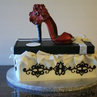 Red Shoe Cake This cake is a white and chocolate cake with buttercream frosting. The shoe on top was totally hand done it took three days to do, I sure...