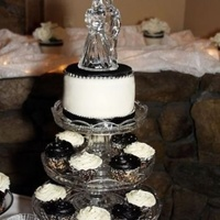 Black And White Wedding Cupcakes for my neighbors wedding with a small 6 in round for the couple to cut and a Harley Davidson grooms cake. the cupcakes were made...