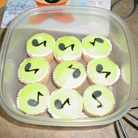 Musical Notes Cupcakes I made these to go along with my son's guitar cake.