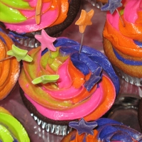 Dance Diva Cupcakes White and Chocolate cupcakes with tye dye buttercream frosting and topped with marshmallow fondant stars