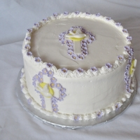 1St Communion White cake with raspberry filing covered in buttercream. Fondant flowers and Crosses