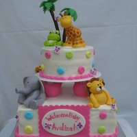 Safari Baby Shower White buttercream frostint with pastel dots piped with rose buttercream. Fondant safari animals (tiger, elephant, giraffe, monkey, lion and...