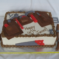Tool Belt Birthday Cake This is a 40th birthday cake, made for a man that likes to built and smokes cigars. It is a marble (chocolate/vanilla) cake with chocolate...