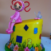 Team Umizoomi Milli Cake Inspire in Milli, one of the umizoomi characters. Some of the flowers and butterflies was made from isomalt. I also use edible sheets and...
