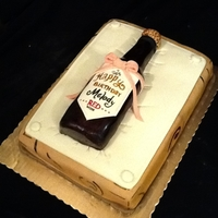 Wine Lover's Cake The bottle is made out of rice krispy treats. Bed is fondant.