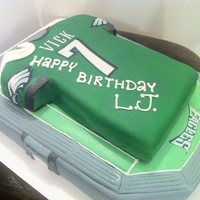 Vick Eagles Cake Michael Vick jersey in fondant over football stadium.