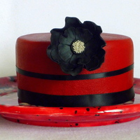 Small Cake With Elegant Large Flower I tried to work with ganache on this cake. It turned out okay! It is a small, simple cake but the black flower makes it a little more...