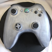 Silver Xbox Controller 3D carved cake in the shape of an xbox controller. i had 2days notice to design and make this. the silver effect is done by using a silver...