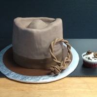 "Indiana Jones Grooms Cake 4 layer (9"") red velvet cake with cream cheese icing. Choco-Pan & Fondant combo on covering"