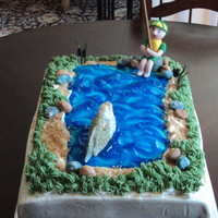 Fish Tale Groom's cake, fishing theme. Italian creme cake, cream cheese icing, buttercream, fondant, and piping gel decorations