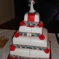 Red Carpet Wedding Cake   i made this for a lovely couple, edible prints in front are pictures of the couple.