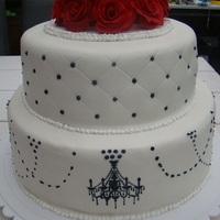 A Touch Of Red   weddingcake covered with marzipan, sugarpaste roses, chandeleer in royal icing