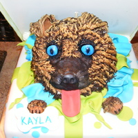 Doggie Surprise! Dog head is rice krispy, fondant and buttercream. Little girl designed the whole thing!