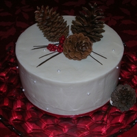 Christmas Cake Pumpkin cake with cream cheese frosting. Real pines cones with fondant needles. Hope you like it!