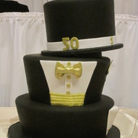 Tuxedo Themed Cake chocolate and red velvet cakes dress in black tie for a 50th birthday celebration.
