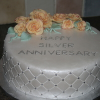 Silver Wedding Anniversary The person who requested this cake asked for something traditional and mentioned that her mothers original flowers were peach roses, so...