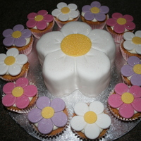 Flower And Flower Cupcakes This was specifically requested - one big flower with lots of little flowers, so there wasnt much else I could do! lol The centre cake was...