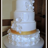 Gold & White Wedding Cake Bottom tier: Vanilla cake with raspberry filling and chocolate ganacheSecond from the bottom: Red Velvet with Cream cheese buttercreamTop 2...