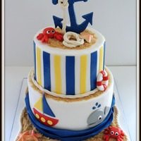 Nautical Baby Shower Cake Vanilla and chocolate cake with swiss meringue buttercream. Star fish made from white chocolate, crabs and anchor made from gumpaste. All...