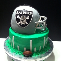 "Raiders Cake WASC cake. The helmet was made with ball pan and a 6"" pan and mask was done with fondant/gumpaste mix. This request was made one day..."