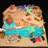 Pirate Treasure Map Buttercream with Fondant and Gumpaste accents. Design on Map drawn with edible marker