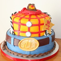 Woody From Toy Story  Tried to make a Woody (toy Story) Themed cake inspired by cakes online. Ran out of time and knowledge, couldn't accomplish the hat for...