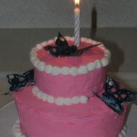 Butterfly Cake. Strawberry cake with buttercream. Butterflies are fondant gumpaste mixture painted with food coloring.