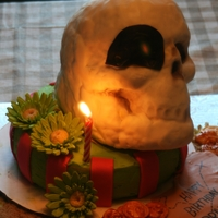 Pirate Birthday. White cake covered with buttercream with fondant accents. Skull is made from Wilton Skull Pan and rice krispies.