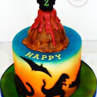 Dinosaur Themed Birthday Cake Fondant Silhouettes Fondant Volcano And Airbrushed Colors By Crumbs Cake Boutique Dinosaur themed birthday cake. Fondant silhouettes, fondant volcano and airbrushed colors. By Crumbs Cake Boutique.